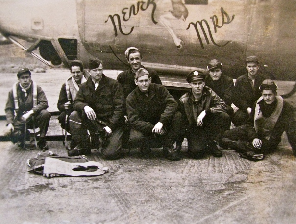 "This is the crew of ""Near Mrs."" Williams, who piloted the B-24, is squatting at the far left. Photo provided"