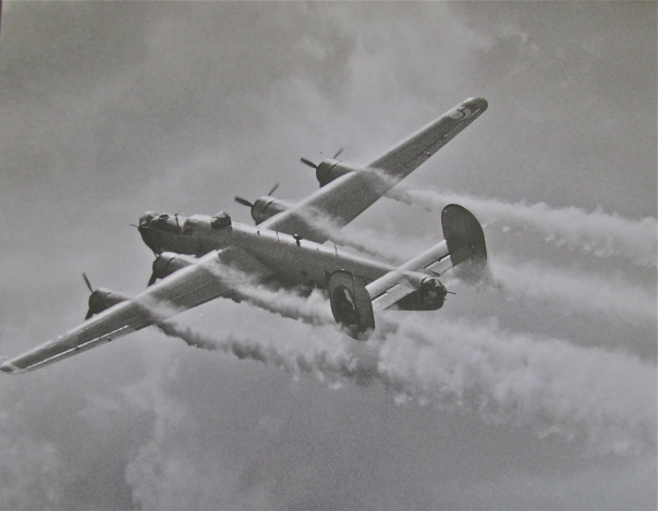 "Contrails stream from the engines of a ""Liberator"" on its way home from a bomb run over Nazi-occupied Europe during World War II. Photo provided"