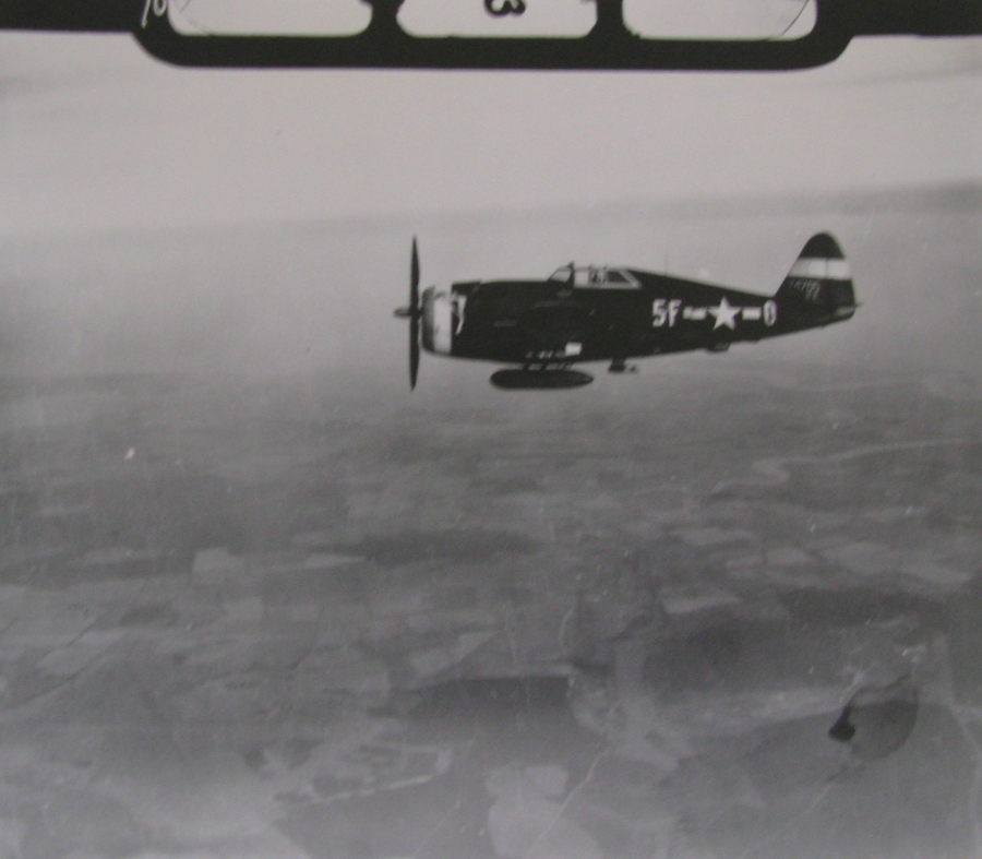 "A P-47 ""Thunderbolt"" fighter provides fighter protection to the bombers on a mission to bomb a German target during the war. It was flying cover for the bombers in Belleson's squadron. Photo provided"