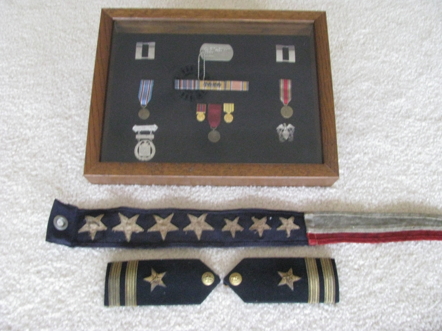 His shadow box has Swillium's Asiatic-Pacific Theatre ribbon with four battle stars for four major conflicts he was in engaged in during the Second World War. He also received a World War II Victory Ribbon and an American Area Campaign Ribbon. His lieutenant's shoulder insignias the ship's pendant his war souvenirs. Sun Photo by Don Moore