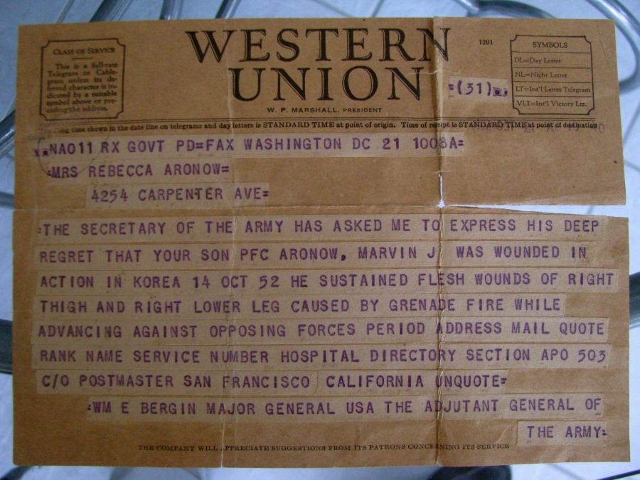 This is the telegram his parents received more than 60 years ago when Aronow was wounded fighting in Korea. Sun photo by Don Moore