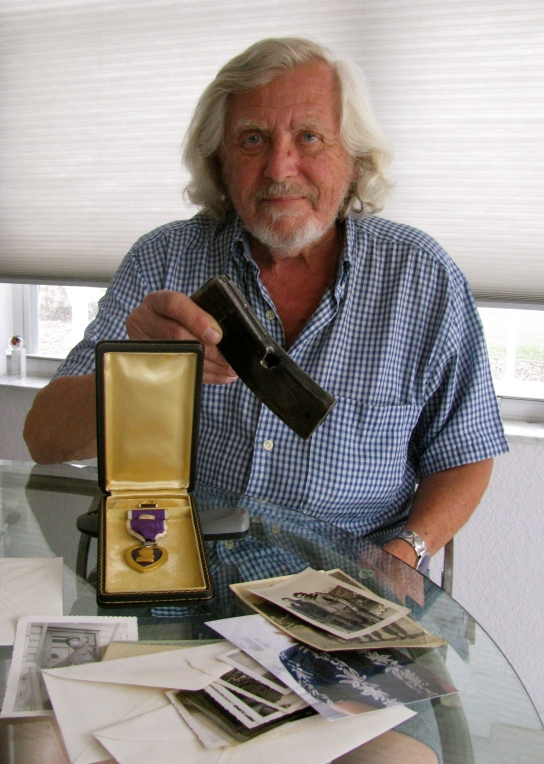Marvin Aronow is pictured with his Purple Heart medal and the clip from his .30 caliber carbine pierced by an enemy bullet during a firefight to take a hill away from the enemy during the Korean War. Sun photo by Don Moore