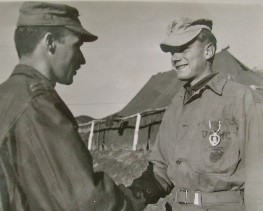 Cpl. Robert Robb receives the Purple Heart from his platoon commander, Lt. Bernie Adams, at a ceremony in Korea during the war. Photo provided