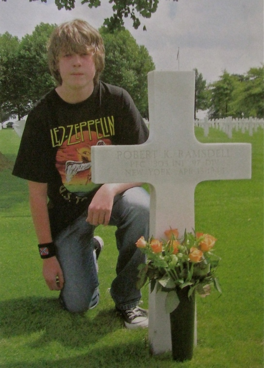 Robin Gulikers of Maastricht, the Netherlands was 15-years-old when this picture was taken of him placing flowers on the grave of Pfc. Robert Ramsdell in the American Military Cemetery in Holland. He is part of a Dutch group that has put flowers of the graves of American servicemen killed liberating their country during World War II. Photo provided