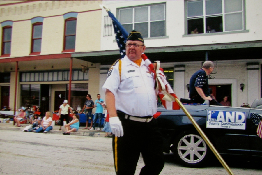 York is part of the DeSoto County Honor Guard that participates in local veteran's activities. He is walking down the middle of Oak Street in Arcadia after a recent Veteran's Day parade. Photo provided