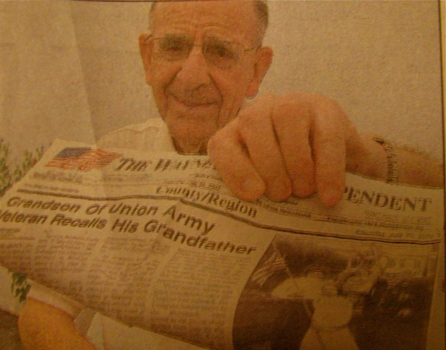 Frank Hochstetter, of Englewood, Fla. holds a newspaper story showing him and his grandfather Franz Baumann, a Civil War veteran. Photo provided by Frank Hochesteter