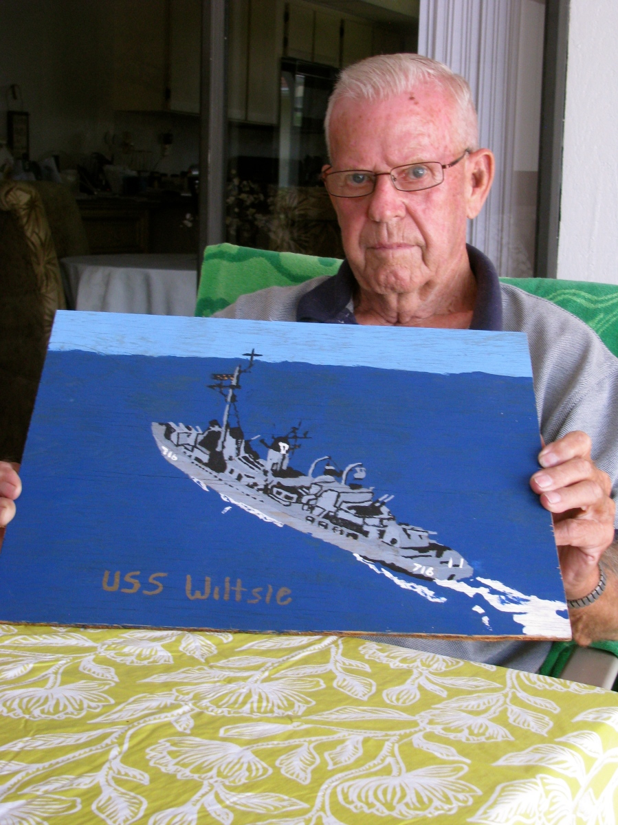 Johnson is proud of the painting his son, Brian, did of his destroyer--USS Wiltsie. Sun photo by Don Moore
