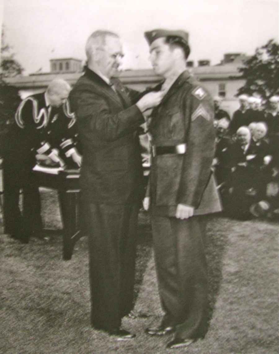 President Harry Truman puts the Medal of Honor around he neck of 20-year-old Cpl. Douglas T. Jacobson on the White House lawn during a ceremony on Oct. 5, 1945. Photo provided by Joan Jacobson.