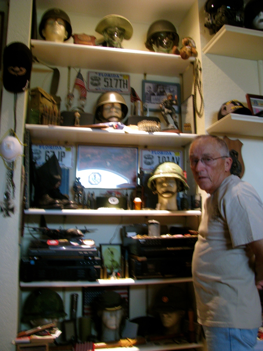 McDonald is pictured in his study crammed full of military paraphernalia. He has over 7,000 items in his collection that's taken him a lifetime to amass. Sun photo by Don Moore