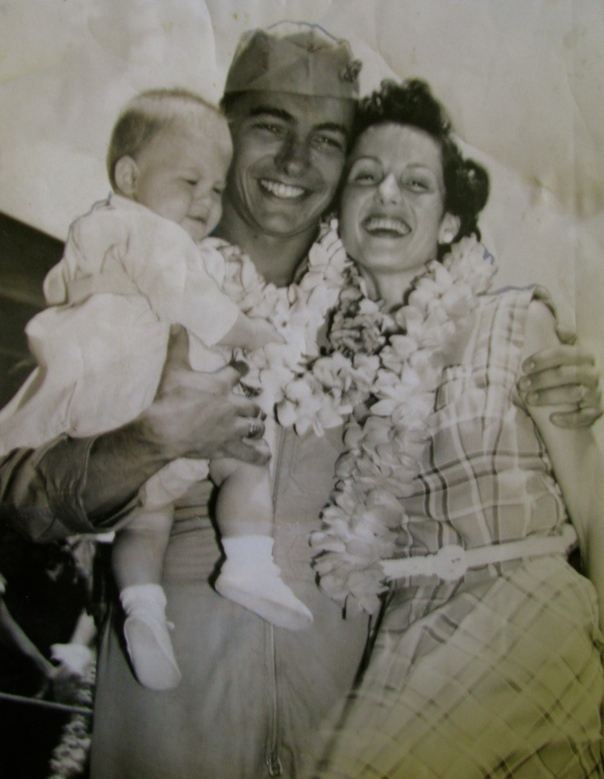 "Ensign Thomas, holding Danny his oldest son, and his wife, Cozette, are all smiles in this Navy photo taken in 1953 when he returned to Hawaii after a six months deployment to Kadena Air Force Base in Okinawa with ""Patrol Squadron 22"" that flew surveillance missions along the coast of China. Photo provided"