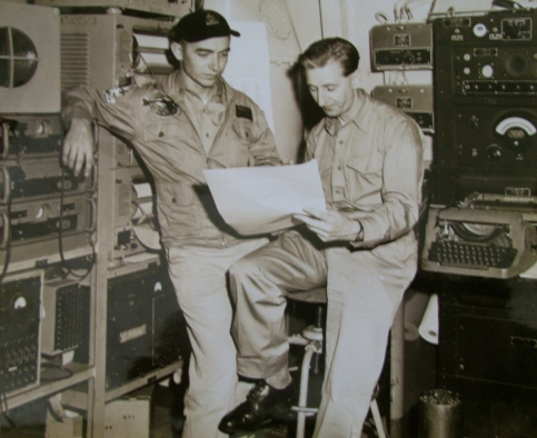 Thomas, on the left, is talking to a British Navy meteorologist aboard the carrier USS Shangri-La during a NATO exercise in the North Atlantic. The two officers got the shock of their lives when they gave Adm. Thomas Moorer a weather briefing aboard his flagship. Photo provided