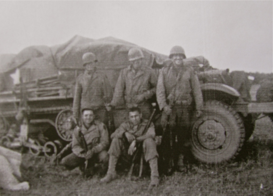 Barth is pictured standing at the far left with his buddies in front of an American halftrack somewhere in Europe. Photo provided