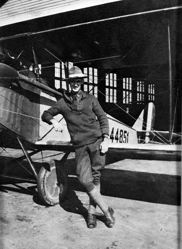 A jaunty un-named World War I aviator leans against his Jennie bi-plane at Carlstrom Field, Arcadia, Fla. in 1918. Photo provided