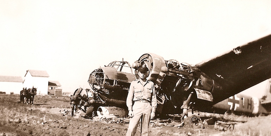 Lt. Erickson stands in front of a wrecked twin-engine German bomber at the American 15th Air Force Base in Fuggia, Italy. Before the Allies captured the base it was a Luftwaffe installation. Photo provided by Mark Erikson
