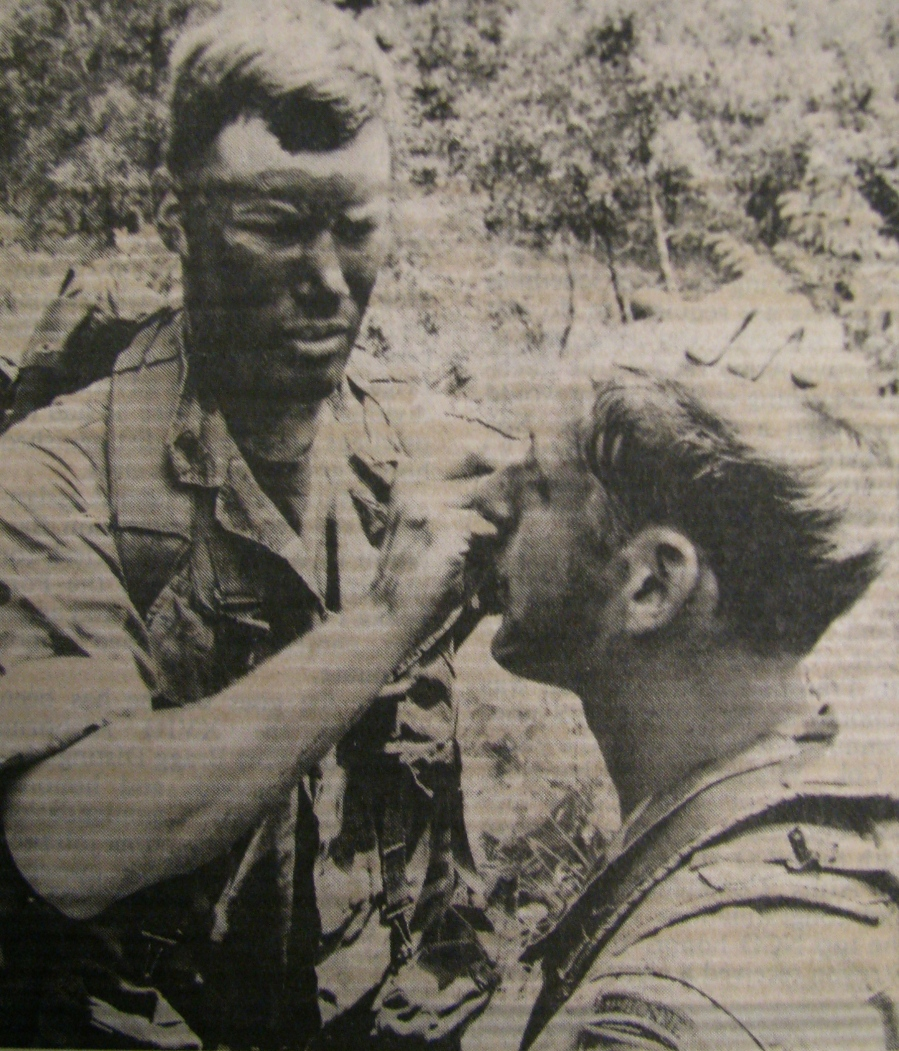 Pfc. David Rockow paints camouflage markings on the face of a fellow paratrooper before the 82nd Airborne's air drop at Eglin Air Force Base in Florida's panhandle in 1980. More than 2,500 paratroopers took part in the exercise. It is suppose to be the largest airborne jump since World War II. Photo provided