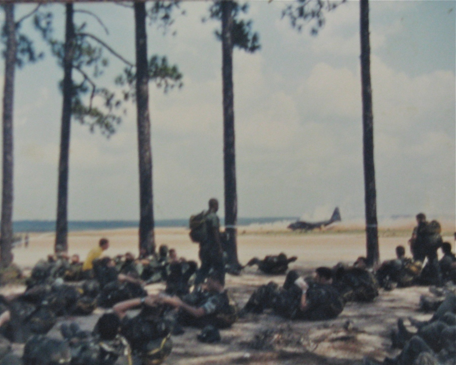 Hackleman and his unit, the 18th Airborne Corps, wait at Fort Bragg, N.C., for C-130 transports to fly them to the fight in Granada in October 1983. In the background, a C-130 can be seen on the runway. Photo provided