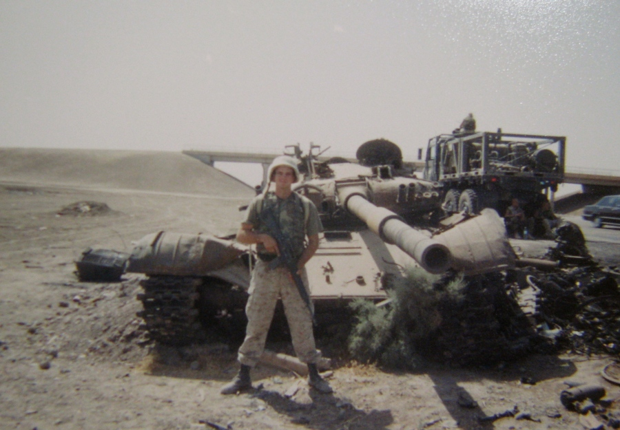 Sgt. Randall Martin of Port Charlotte stands in front of what remains of an Iraqi tank sitting along a road southwest of Falluja. It was put out of commission by an American Abram tank during the Gulf War. Photo provided
