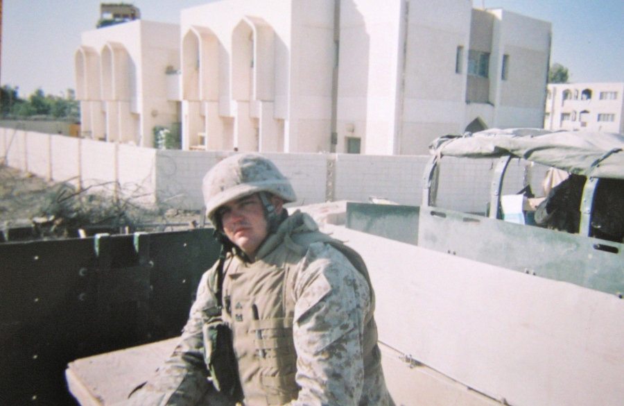 Martin stands in front of a building in Falluja his battalion used as a base of operation. Photo provided
