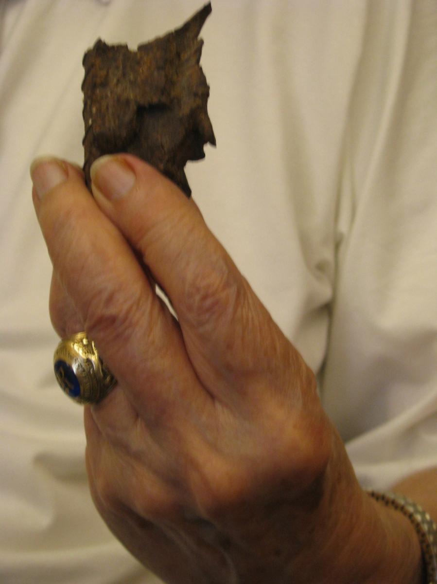 Rohn holding the lethal piece of shrapnel xxxxxxxxxxxxxxxxx