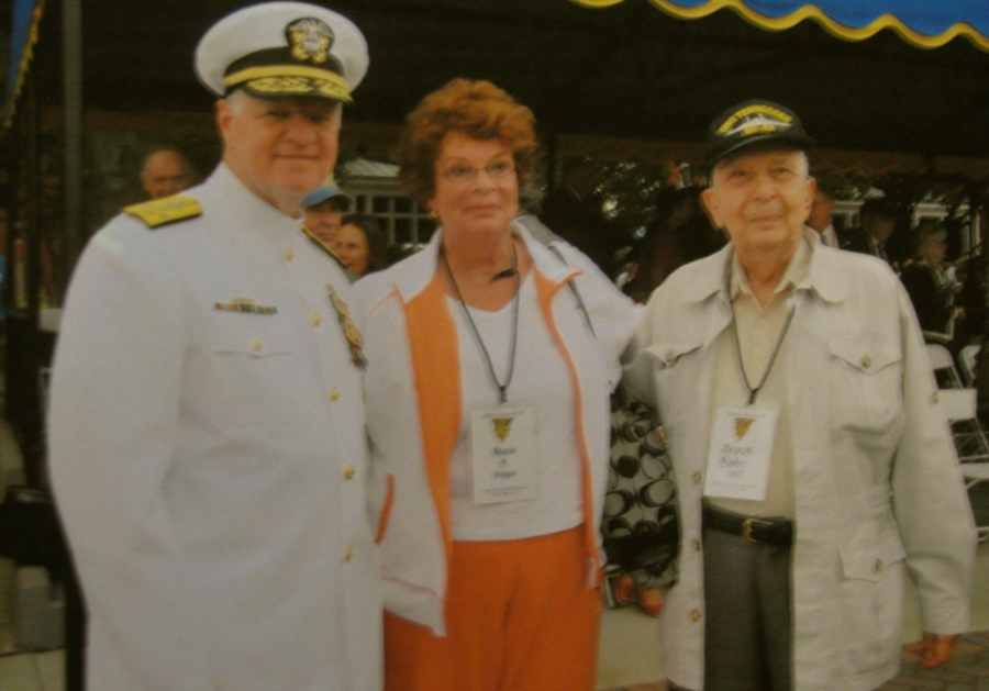 Rohn and his daughter, Marie Anne, talk with Adm. Gary Roughdiad, commanding officer of the U.S. Navy, during Rohn's 70th graduation anniversary at Annapolis in 2010.
