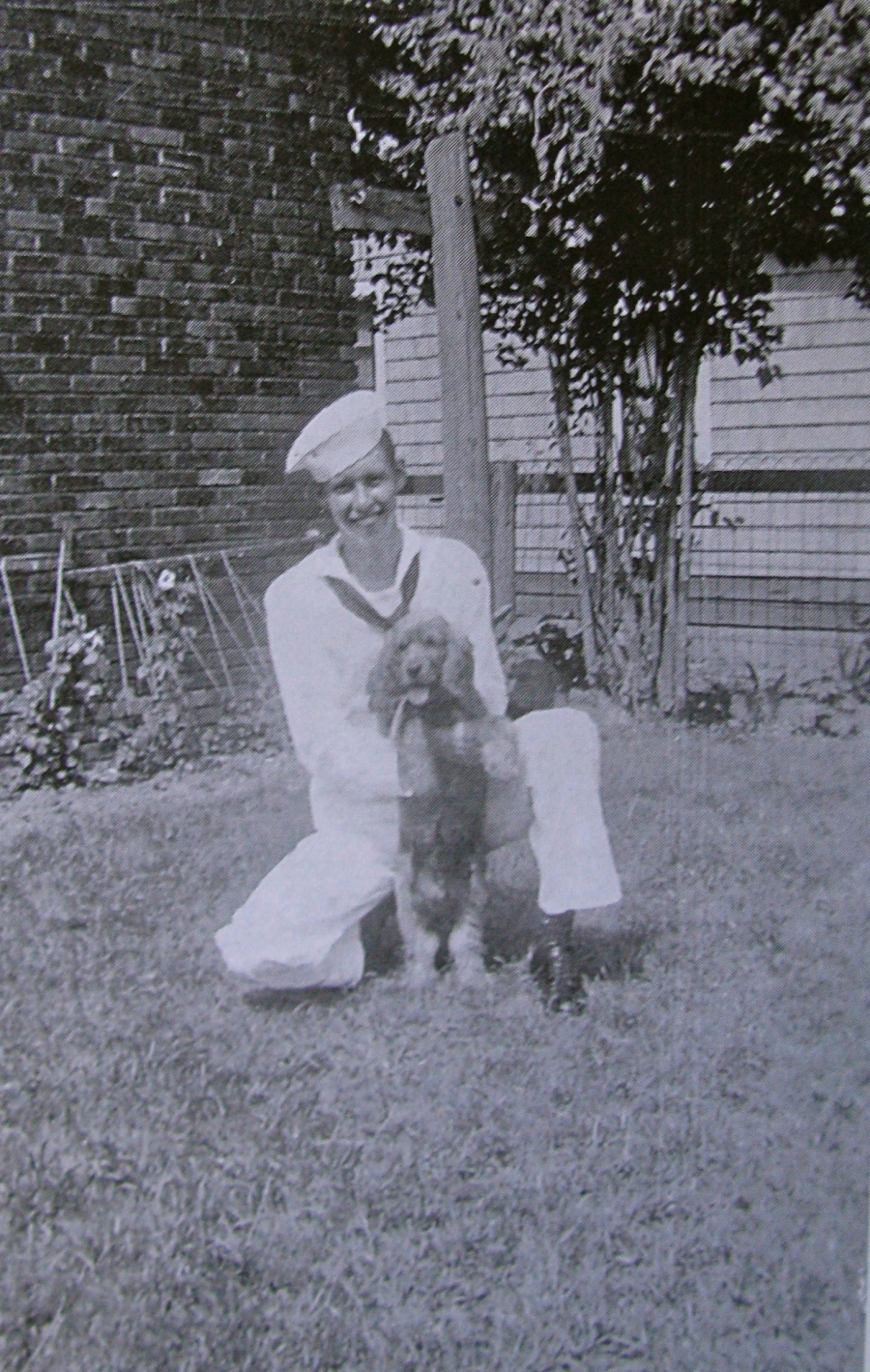 Bob Watts of Port Charlotte, Fla. with his cocker, Rusty, while on leave back home in Detroit, Mich. during the Second World War. Photo provided