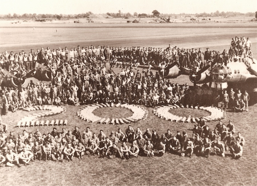 "This was Erickson's Air Group in Ipswich touting the fact that collectively over the months the group had flown 200 combat missions in World War II. He is somewhere in the sea of faces. Note the figure ""200"" is spelled out in bombs. Photo provided by Mark Erickson"
