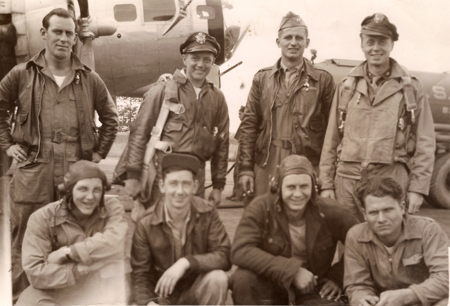 The crew of 'Lili of the Lamplight,' a B-17 bomber based near Ipswich, England was part of the American 8th Air Force. Lt. Ernest Erickson, pictured sanding at the far right, piloted the four-engine, heavy bomber.  Photo provided by Mark Erickson, his son