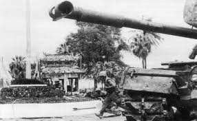 U.S. Marines advance past an M48 Patton tank during the battle for Huế. Photo provided