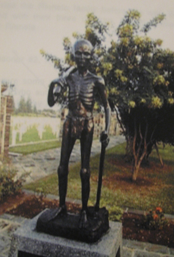 This bronze statue of an emaciated little boy with a hoe over his shoulder and an ax in his hand stands at the entrance to the Kali Bantentg Cemetery in Semarang, Java, where some of the children from the concentration camp Robert was in are buried. Photo provided by Robert Riensta