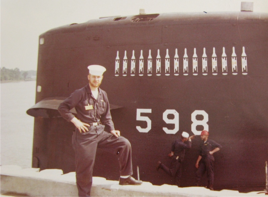 Dundas stands beside the nuclear submarine, USS George Washington, SSBN-598, at its base in Charleston, S.C. in 1964. He served aboard the sub at that point. Photo provided