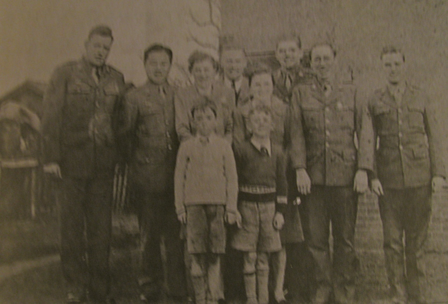 taff Sgt. Charles Renshaw, who served with the 8th Air Force in England, stands second from the left in the middle row. Peter Brown, the 9-year-old youth who got the airman's signature at the end of the war, is believed to be standing beside him.