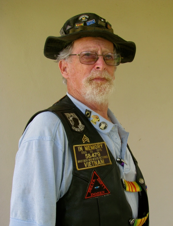 Herb Mc Cool in his Vietnam vest and hat at 66. He served three tours in Vietnam from '67 thru '69. Sun photo by Don Moore
