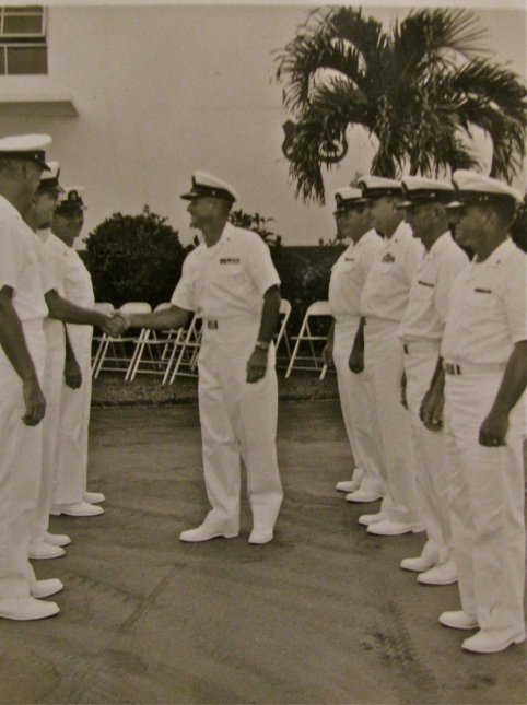 Medina inspects the sailors who worked with him in the small engine shop the Navy ran in Key West. By this time he had spent 20 years in the Navy and was retiring.