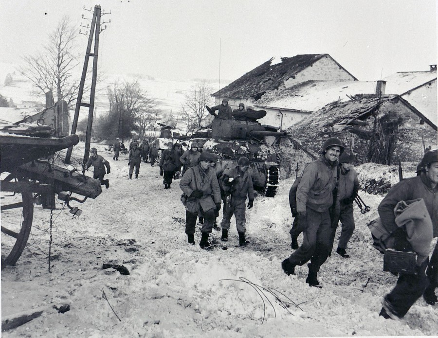 American soldiers slog through the mud and snow during the Battle of the Bulge in December 1944. It  was the coldest winer in 50 years in Europe and developed into the biggest battle on the Western Front during World War II. Photo provide