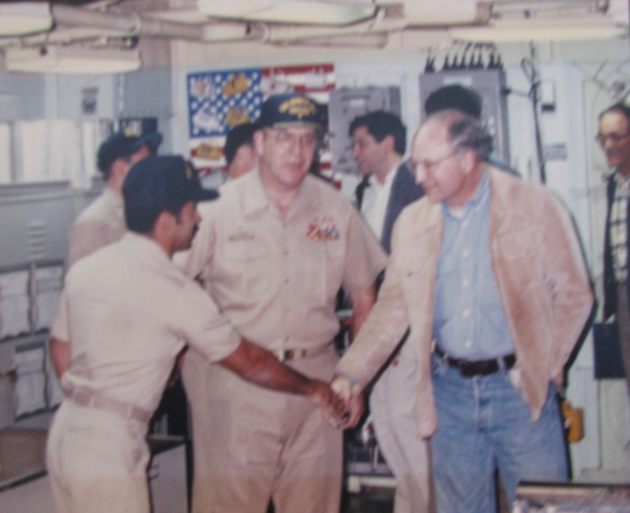 "Avenancio shakes hands with Secretary of War Dick Chaney aboard the guided missile cruiser USS Bunker Hill during the start of ""Desert Storm,' the Gulf War in 1990."