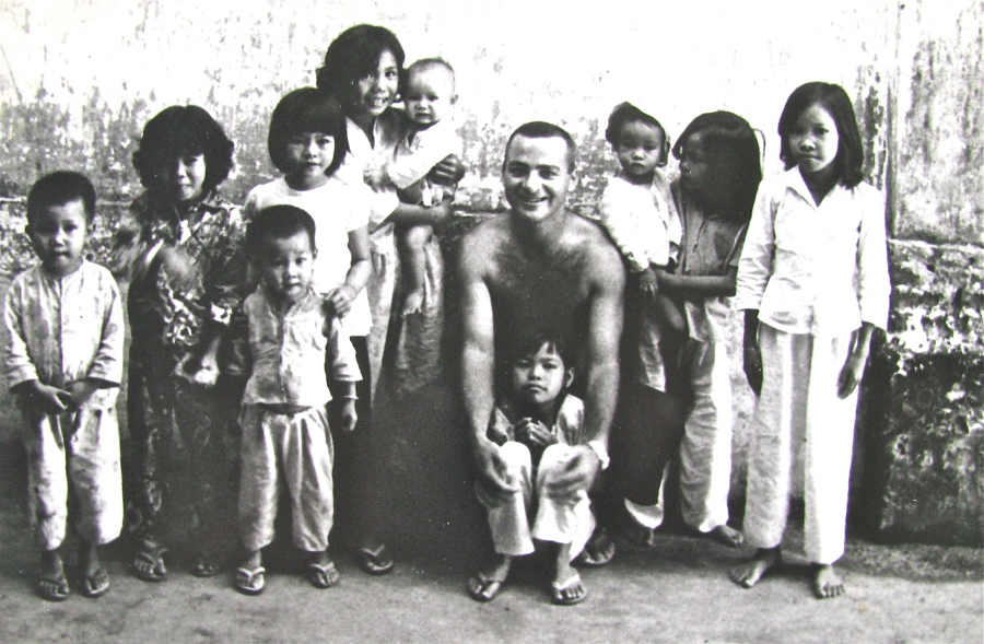 Because he could speak the language Entlich always had a group of Vietnamese kids around him in the various villages and hamlets in the Mekong Delta where he worked in the southern part of the country. Photo provided