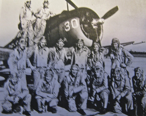 Lt. j.g. Bill Timmis is standing on the wing against the Curtis SB2C Helldiver. He was an instructor at Daytona Naval Air Station teaching this group of would-be Naval Aviators how to fly. Photo provided