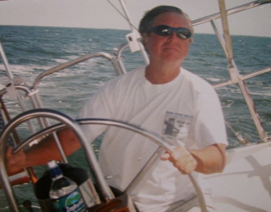 Stuart enjoying the good life at the wheel of his 45-foot Ketch Nelson's Blood rigged sailboat docked in a canal in his back yard in South Punta Gorda. Photo provided