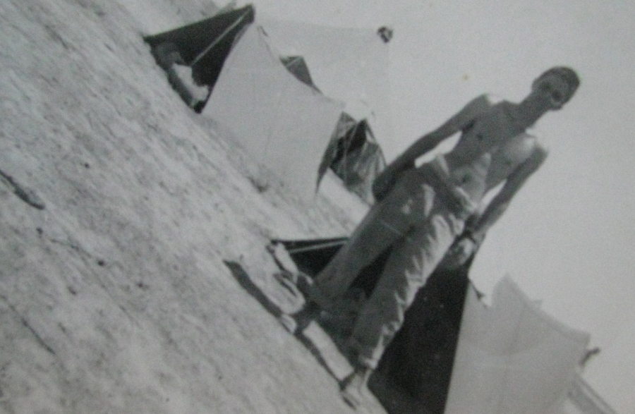 "Twenty-year-old Vern Greenwood stands in front of a pup tent during maneuvers in the New Mexico desert in 1943. This was before he became a bombardier on a B-24 ""Liberator"" bomber in the 13th Air Force in the Pacific during World War II. Photo provided"