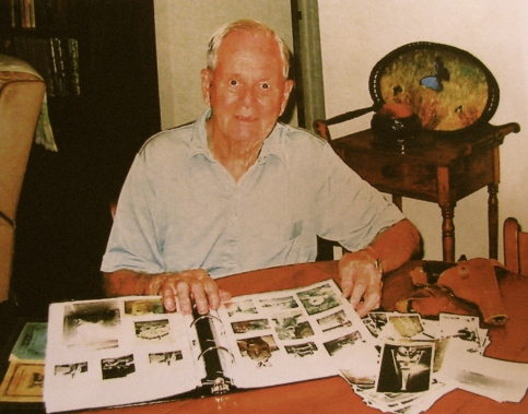 Eddy Edwards at his Port Charlotte home at 89. He has hundreds of World War II pictures he took and printed more than half a century ago. Sun photo by Don Moore