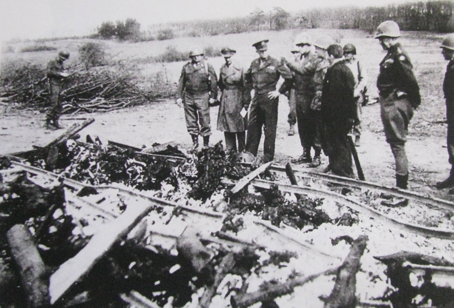 Supreme Allied Commander Gen. Dwight D. Eisenhower stands in the group third from the left. To his left is Gen. Omar Bradley, commander of the 12th Army Group, and standing second from the right, wearing riding breeches and boots is Gen. George Patton, commander of the 3rd Army. They're looking at the charred remains of bodies at Dachau Concentration Camp outside Munich, Germany. Photo provided by Eddy Edwards