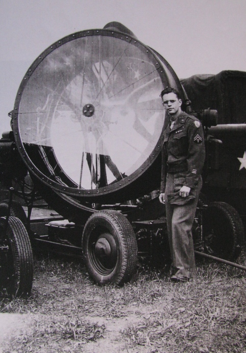 Sgt. Eddy Edwards of Port Charlotte, Fla. stands beside an aviation search light that produced 800,000,000 candle-power. He was a member of the Air Corp's 225th Anti-Aircaft Artillery Search Light Battalion in Europe during World War II. Photo provided by Eddy Edwards