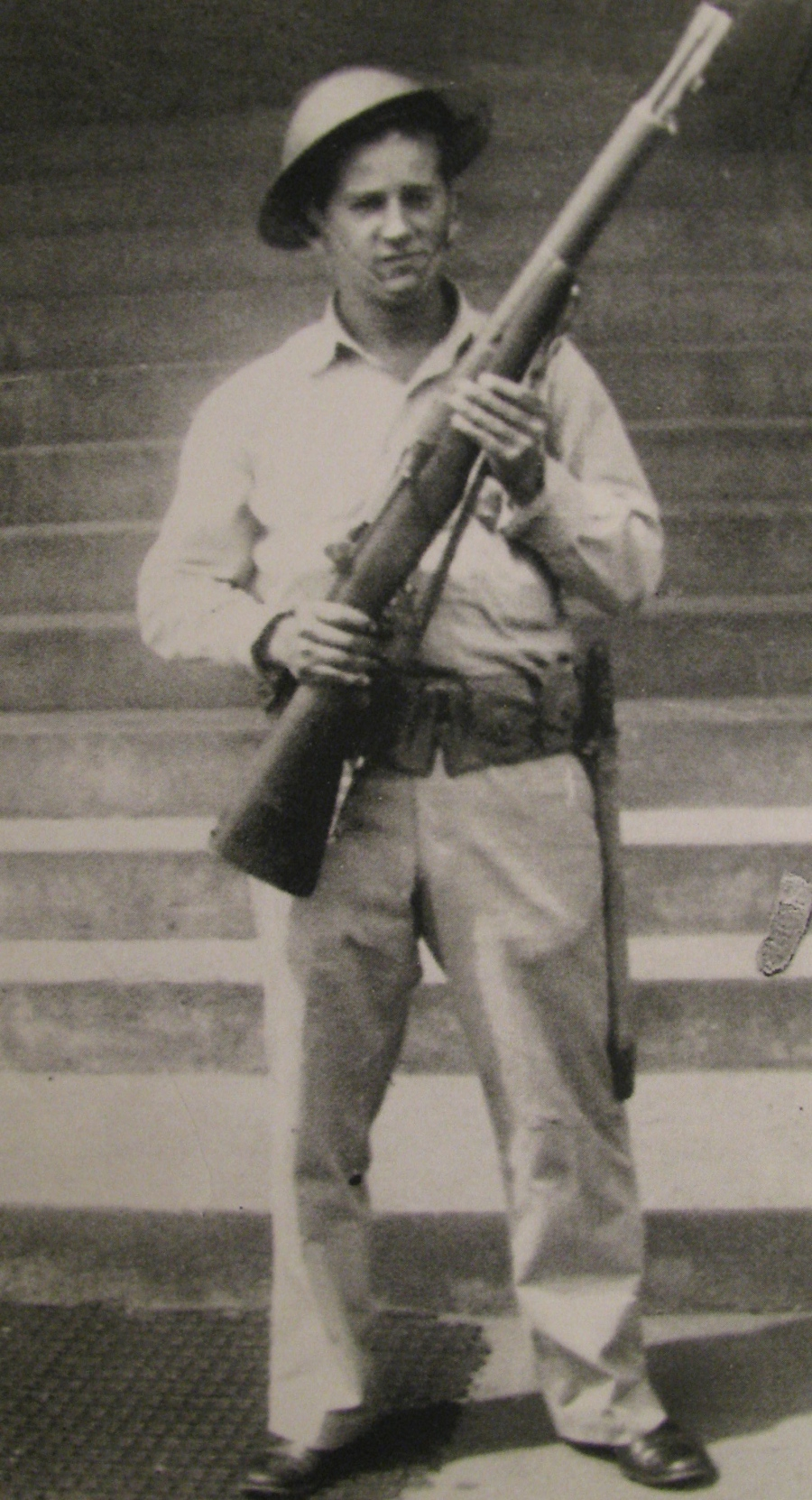 Pvt. Marty Mestre holds an M-1 rifle for this picture taken in Hawaii in 1943. Note the World War I helmet he's wearing. Photo provided by Marty Mestre