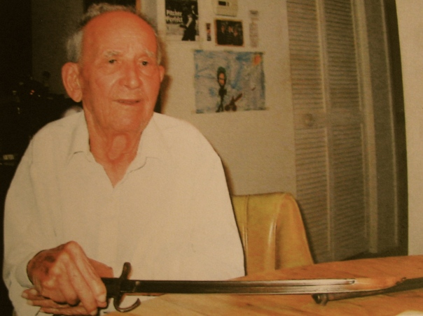 Mestre holds a Japanese bayonet he took from an enemy sooldier he shot who was trying to get up close and personal with it while Mestre and a buddy were in a foxhole one night on Saipan. Sun photo by Don Moore