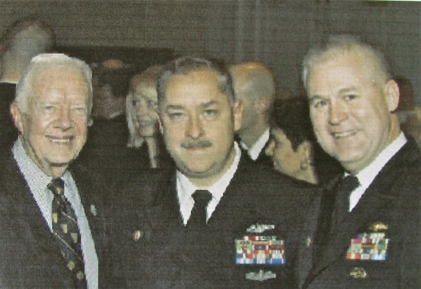 Former President Jimmy Carter (left) was on hand in 2006 for the commissioning of an atomic submarine christened in his name at the sub base in Bangor, Wash. On hand was Command Master Chief Sanzalone (center) and Commodore Mack Myers, commander of Squadron-5 based at Bangor. Photo provided