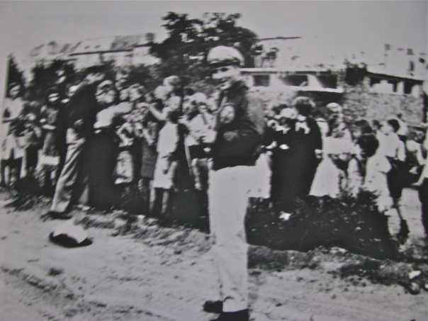 Pickering is pictured in the foreground standing in front of a group of Berlin children who received candy bars parachuted into them by his transport squadron that took part in the Berlin Air Lift in 1948. Photo provided by John Pickering