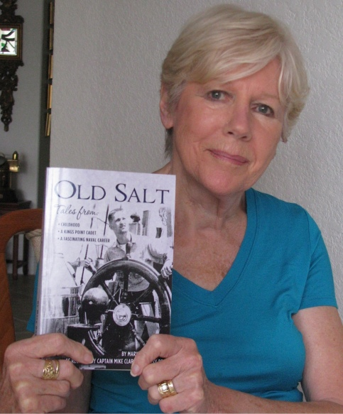 "Mary Clarity holds ""Old Salt,"" the biography she wrote about her husband's service in the Naval service during the ""Cold War. Sun photo by Don Moore"