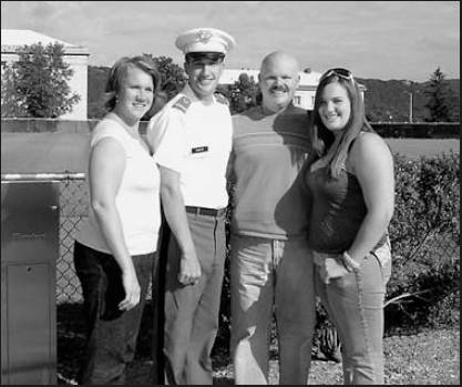 Bryan is flanked by his mom, dad and sister, Meredith, during a visit the family made to West Point. Photo provided by Bryan Coward