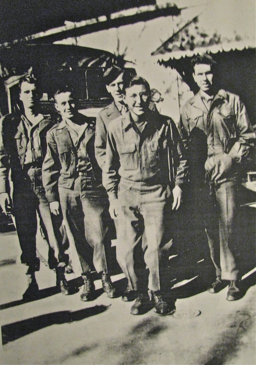 Pfc. Richard Erdley stans in the front with a smile while his buddies stand behind. They are about to check out Metz, France in June 1945 a few days after the end of World War II in Europe. Photo provided by Richard Erdley