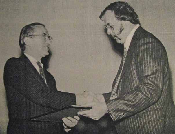 "The director of the CIA (left) presents Tom Poole with the ""Intelligence Star,"" the second highest honor a field agent can receie. On the bottom of the picture the head man at the ""Agency"" wrote: ""To Thomas Poole - With appreciation and admiration for your courageous and effective work --W.F. Colby 29/Mar/74."" Photo provided"